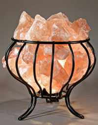 All new our hand made Feng Shui Salt Lamp comes with premium salt chucks and a high quality enameled basket. Himalayan Salt chucks glow and glisten in the amber light tones. Himalayan Salt lamps are evolving to become and import part of every home.  www.spiritualquest.com