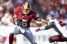 Washington Redskins running back Alfred Morris stiff arms Tampa Bay Buccaneers cornerback Eric Wright. Week 4 2012 Season