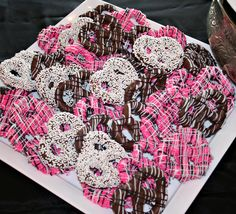 Zebra Pretzels -- just dip in almond bark (chocolate, white, or white w/ food coloring), drizzle and let cool on waxed paper.