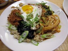 Get Oat Congee with Fried Eggs and Scallions Recipe from Cooking Channel