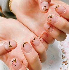 Small gold hearts nail art
