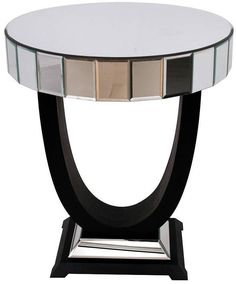 A fabulous round mirrored side table with fabulous Art Deco styling A fully encompassed mirrored glass top, with sides of individually bevelled glass squares, sits on an inverted arch, which is itself supported by a mirrored glass pyramid with a black painted base This is a stylish and impeccably manufactured side table which will look absolutely wonderful wherever she is placed.  #Ad