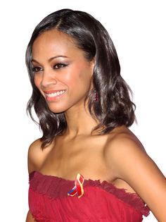Shoulder-skimming curls like the ones on Zoe Saldana rely on a few soft layers around the face.   - Redbook.com