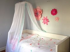 Tug a hula hoop through a sheer curtain panel for THIS http://www.hometalk.com/27905796/hula-hoop-canopy-with-pom-poms?se=fol_new-20170307-1&date=20170307&slg=8cd8b7da28226b1469c4154db0b114eb-1110481&post_position=1