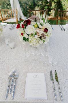 Romantic white blush hint of red wedding flower centerpiece.@latavolalinen , @ColeDrakeEvents, @brianamarie Photography, @calistogaranch Fleurs de France. www.fleursfrance.com. Napa Wedding florist. Destination wedding. www.fleursfrance.com