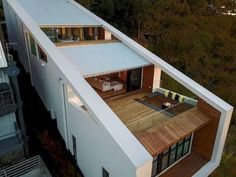 The shape of a sloping form is designed based on the sloping soil structure. This form makes the building look more attractive from the outside. With an ideal sloping structure, several levels in the Roof Architecture, Modern Architecture House, Concept Architecture, Modern Buildings, Sustainable Architecture, Residential Architecture, Building Design, Building A House, Green Building