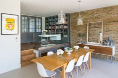 Modern London Residence by Granit Chartered February in Wandsworth, London, England, Broadgates Road is a private home designed by Granit Chartered Architects. Open Plan Kitchen Living Room, Open Plan Living, Kitchen Dining, Kitchen Mantle, Dining Room Design, Dining Area, Dining Rooms, Dining Table, Split Level Kitchen