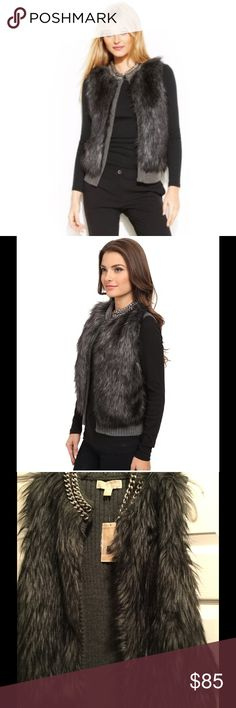 Michael Kors faux fur chain collared vest Michael Kors faux fur chain collared vest in black gray.  This vest is a a cable knit sweater on the back, no fur.  Comes from a smoke and pet free home Michael Kors Jackets & Coats Vests