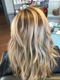 Hair painting with a shadowed root and cool blonde.