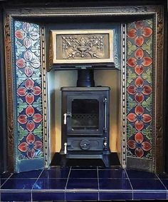 Antique Tiled Insert with the Hobbit stove and metal fireback on a tiled hearth. : Antique Tiled Insert with the Hobbit stove and metal fireback on a tiled hearth. Log Burner Fireplace, Fireplace Tile Surround, Metal Fireplace, Fireplace Inserts, Modern Fireplace, Fireplace Ideas, Wood Stove Surround, Craftsman Fireplace, Farmhouse Fireplace
