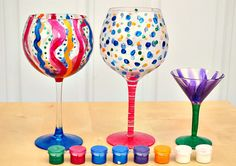 DIY painted wine glasses  What you'll need:    Glass stemware (can be wine, martini or champagne glasses)  Set of brightly colored glass enamel paint  Set of different-size brushes (from angled tips to larger rounds for different effects)  Surface conditioner (like this)  Newspaper  Stencils (optional)