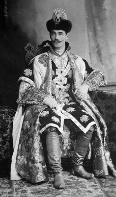 large studio photograph of Grand Duke Michael Alexandrovich (younger brother of czar Nicholas II) wearing 17th century boyar dress at the costume ball which took place in the Winter Palace on February 11 and 13, 1903, by court photographer Levitsky, St. Petersburg.