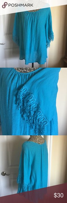Turquoise Peasant Top Beautiful color for summer! Tassel lace embellished 3/4 sleeves. Scoop neckline. Tunic length. Tops Tunics