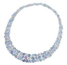 Lot 118 - AN 18 CARAT GOLD, SAPPHIRE AND DIAMOND NECKLACE Of tapering collar design, composed of a series of oval mixed-cut pink, violet and blue sapphire and diamond point clusters, with diamond-set bar highlights between, to a concealed clasp, London hallmarks for 18 ct gold, 51.5cm long Christie's Important Jewels, London,12/12/12