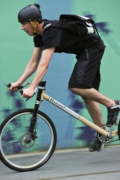 Rider on a seatless bicycle - Manhattan Bridge