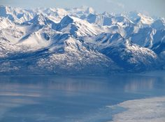 This is a photo of the Chugach mountains that lie behind Anchorage Alaska. The water is a branch of the cook inlet called the Turnagain Arm.