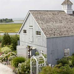 Barn-style on the Marsh. Weathered Cedar roof, soft grey. Lovely cottage style gardens.