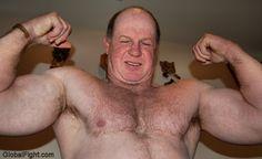 powerlifter flexing powerfull biceps