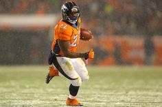 Running back C.J. Anderson #22 of the Denver Broncos rushes for a touchdown against the New England Patriots in the fourth quarter at Sports Authority Field at Mile High on November 29, 2015 in Denver, Colorado.