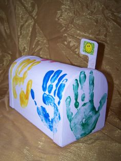 We bought this cardboard mailbox at Hobby Lobby, painted it white and put our whole family's hand prints on it with paint. My kids came up with the design themselves We plan to use it to deliver 'mail' to each other - a great way to encourage them to practice letter writing skills!