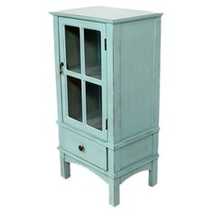 Handcrafted one-drawer cabinet in blue with one door and interior storage.  Product: CabinetConstruction Material: