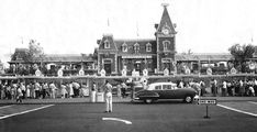 """I doubt that I'll ever get sick of going to Disneyland, but you do have to go through a whole parking-and-security gamut these days just to get into the park. That certainly wasn't the case when Disneyland opened in 1955, the year that this photo was taken. From the looks of that circa 1949 Oldsmobile parked out front, you could just drive right up to the Main Gate and drop off your family. I love how he's parked facing right and the """"One Way"""" sign is facing left."""