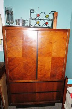 Mid-Century Modern solid wood dresser with beautiful quarter sawn wood grains. 2 doors over 2 drawers, top section has 3 cubbies and one drawer, bottom section has 2 drawers, x x Solid Wood Dresser, Saw Wood, Mid Century Style, Cubbies, Wood Grain, Armoire, Mid-century Modern, Grains, Drawers