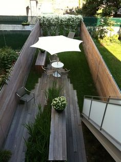 "This is actually really neat. I like the transformation from grass to somewhat of a patio. It would be perfect for someone who had small space but still wanted ""different"""