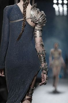 Devials armor at the ball to show she is the protector queen