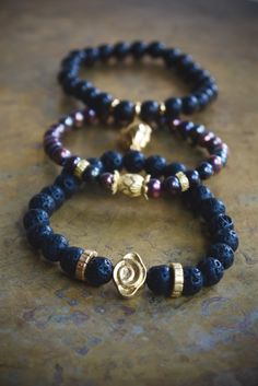 A dark and moody mala stack. Gorgeous boho luxe jewelry from Pillow Book Design