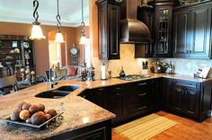 Dark cabinets and light countertop.