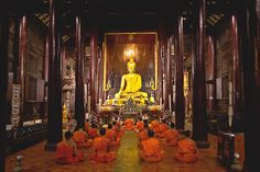 Monks chanting at Wat Phan Tao in the old walled city of Chiang Mai, Thailand