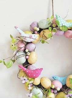Easter decoration ideas outdoor front door wreath colored eggs cloth birds.