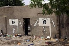 A wall painted by Boko Haram is pictured in Damasak March 24, 2015. REUTERS/Joe Penney
