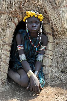 Ethiopian Mursi woman in hut
