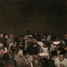 "One of the hyperrealistic mosh pit paintings, entitled ""N.Y. Hardcore Paintings,"" by Dan Witz."
