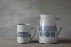 thrown stoneware mug and jug with circle decoration by James and Tilla Waters