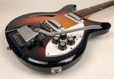 In the early during the Japanese guitar boom, Teisco Gen Gakki was making guitars for Teisco. The guitar has the typical playwear of a Teisco. Archtop Acoustic Guitar, Guitar Tuners, Vintage Electric Guitars, Vintage Guitars, Japanese Guitar, Guitar Body, Body Electric, Cool Guitar, Vintage Country