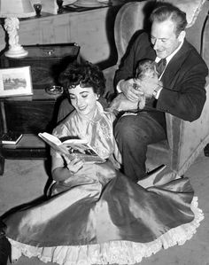 Elizabeth Taylor and Michael Wilding read about the Barrymores. May, 1952
