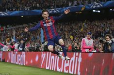 Messi flies through the air as he celebrates his goal against Bayern Munich at the Nou Camp as he helped Barca reach the final