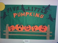 5 little pumpkins sitting on a gate for the wall