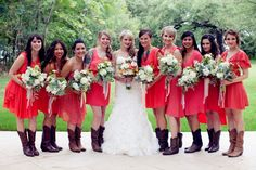 rustic bridesmaid dresses with cowboy boots | Bright coral bridesmaid dresses with cowboy boots.