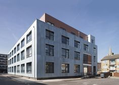 Sarah Wigglesworth Architects adds new metal skin to London factory containing artists' studios