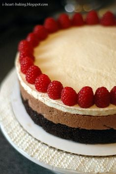 triple chocolate mousse cake with raspberries