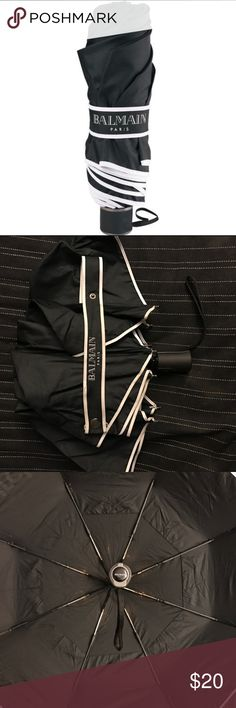 Balmain Authentic Black & White Strong Umbrella This Authentic Balmain umbrella is perfection! It retracts to a small size perfect to fit into your bag or purse. The black base with white accents goes well with all outfits while the strong steel frame works to combat any wind. This umbrella has been personalized with the word Purch. Please view all photos for accurate depiction of product's condition. 😊 it's in excellent shape and will last for years to come! Balmain Accessories Umbrellas