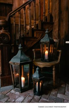 I'd love to find lanterns like this for the wedding! Obsessed with that warm wooden staircase and the rough brick floor, as well as the old lanterns. Reminds me of a dark fairytale. Chandelier Bougie, Old Lanterns, Antique Lanterns, Rustic Lanterns, Hurricane Lanterns, Br House, Decoration Entree, Oil Lamps, My Dream Home
