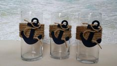 "The Nautical Vases are wrapped in premium natural fiber rope and completed with an anchor with rope wrapped around it. Anchor is painted in the color of your choice (shown in Navy). You can use them as vases for flowers, with a floating candle, a votive or a 3"" wide candle.The vases are available in both 7.5"" (shown) and 9"", each are 3 1/4"" wide. Great to use for weddings, parties, banquets and other special occasions. ***Set of 3**Please message me for a custom listing..."