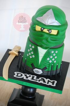 The Royal Bakery - Green Lego Ninjago cake for Dylan with modeling chocolate sword. Lego Ninjago Cake, Ninjago Party, Lego Cake, Lego Torte, Ninja Cake, Pistachio Cake, Bowl Cake, Apple Smoothies, Modeling Chocolate
