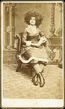"""""""In the 1860s, a style similar to the Afro was worn by the Circassian beauties, sometimes known as """"Moss-haired girls"""", a group of women exhibited in sideshow attractions in the United States by P. T. Barnum and others. These women were claimed to be from the Circassian people in the Northern Caucasus region, and were marketed to white audiences captivated by the """"exotic East"""" as pure examples of the Caucasian white race who were kept as sexual slaves in Turkish harems."""""""