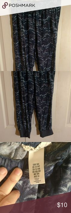 Capri length girls pants H&M Tropical pattern in 3 shades of blue. Elastic waist size 13-14. Cuffs at bottom. So comfortable my daughter is sad she out grew them H&M Bottoms Casual